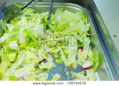food, catering, eating and cooking concept - close up of romaine lettuce salad in metallic container