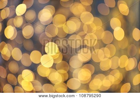 christmas, holidays and background concept - blurred golden lights bokeh