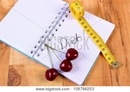 Cherry And Centimeter With Notebook, Slimming And Healthy Food
