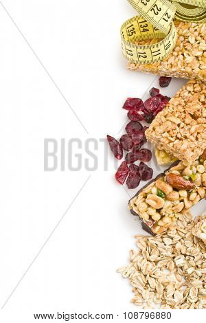 muesli bars with raisins and oat flakes on white background