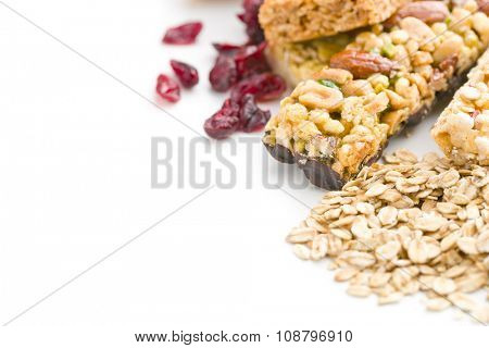 muesli bars with raisins and oat flakes on white background