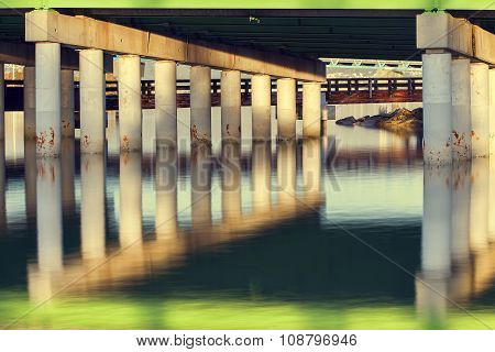 Bridge Pillars And Reflections