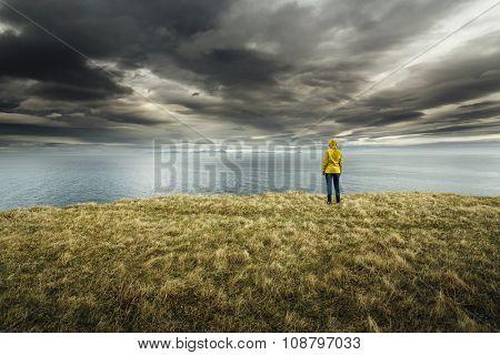 Woman contemplating a beautiful landscape