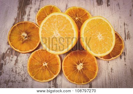 Vintage Photo, Dried And Fresh Orange On Old Wooden Background