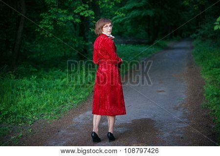 Young Woman In Red Coat