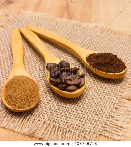 Grains, Ground And Instant Coffee With Wooden Spoon On Jute Canvas