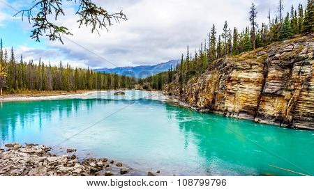The  turquoise colored water of the Athabasca River