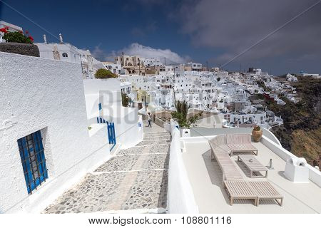 View Of Oia Traditional White Houses And Old Castle Of Oia, Santorini, Greece. View From Above