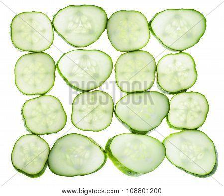 Many Slices Of Fresh Cucumber Isolated On White