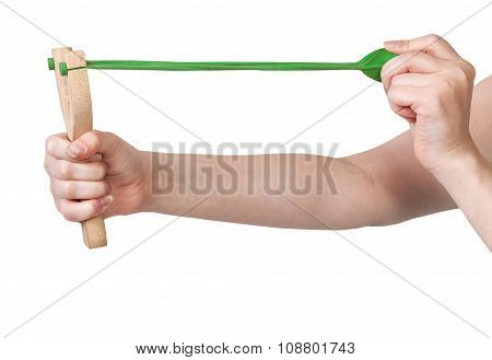Hands Pulling Green Band Of Wooden Slingshot