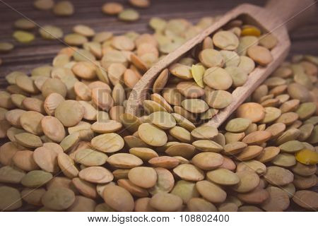 Vintage Photo, Heap Of Green Lentil With Spoon On Wooden Background