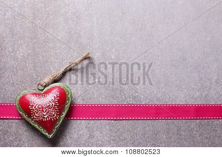 Decorative  Heart  And Ribbon On  Grey Slate  Background