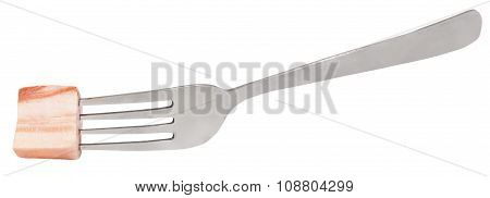 Fork With Impaled Piece Of Salty Lard Isolated