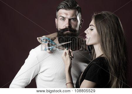 Woman Cuttin Male Beard