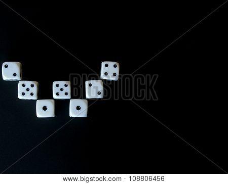 Multiple dice forming letter 'w' for winner