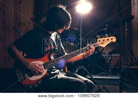 guy playing bass guitar