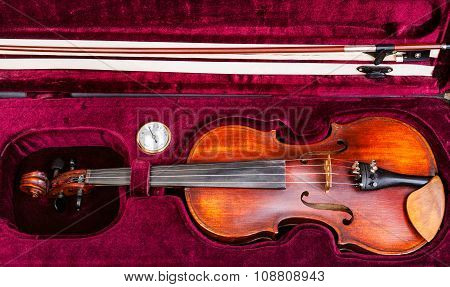 Top View Of Old Violin With Bow In Red Velvet Case