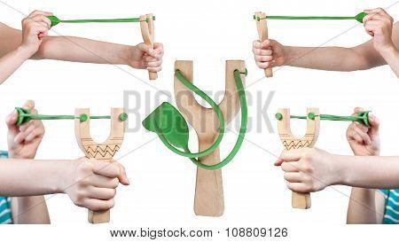 Set Of Female Hands With Wooden Slingshot