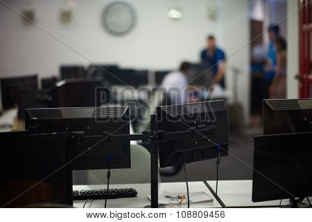 dual monitor screen and laptop computer at modern office indoors, startup company software develop  technology