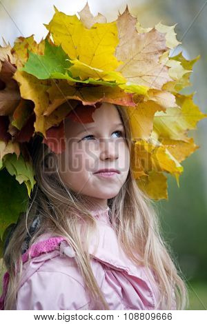 Funny Smiling Girl In Maple Leaves Wreath On Her Head