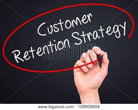 Man Hand writing Customer Retention Strategy with black marker on visual screen.