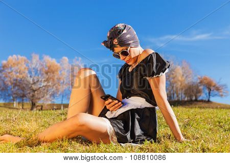 housewife sitting in the grass
