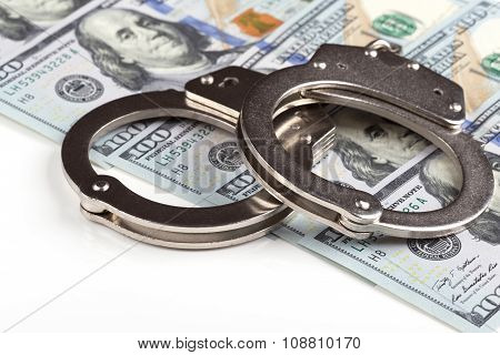 Handcuffs On Dollar Banknotes