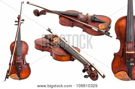 Set Of Old Violins With Bows Isolated On White