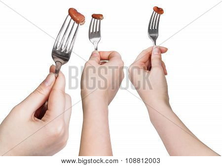 Set Of Dinning Forks With Impaled Brown Bean