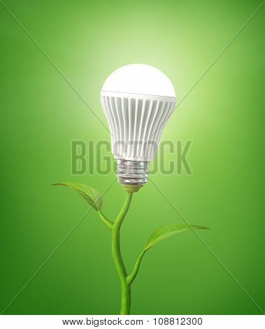 Concept Of Green Energy. The Led Light Bulb Illuminated On Stem Of Plant On A Green Background.
