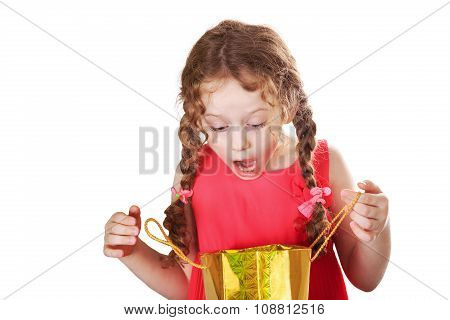 Surprised Girl Looks At A Shopping Bags, Isolated On White.