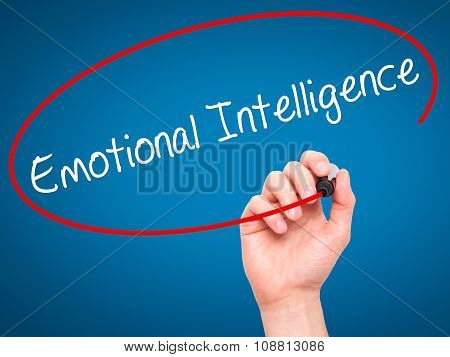 Man Hand writing Emotional Intelligence with black marker on visual screen.