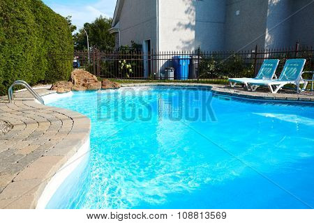 Beautiful swimming pool with a blue clear water.