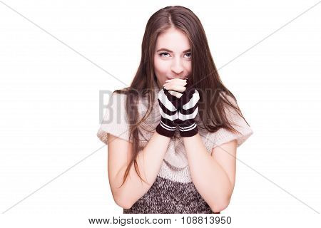Woman Blowing In Her Hands Of Cold
