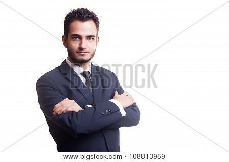 Businessman With Crossed Arm Isolated Over White Background