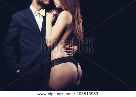 Gorgeous Woman In Underwear Next To Men In Suit Artistic Toning