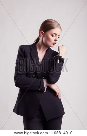 Woman In Fashion Suit On Grey Background