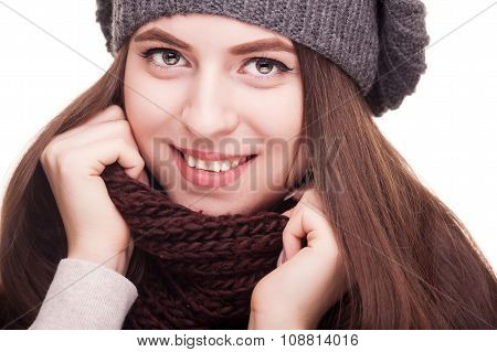 Girl Smiling At Camera In Winter Scarf