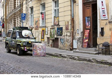 TALLINN ESTONIA- JUNE 16: Brightly decorated car advertizes an input in art gallery in the Old city