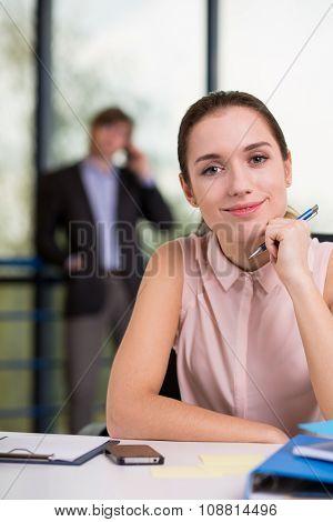 Female Employee By Office Desk