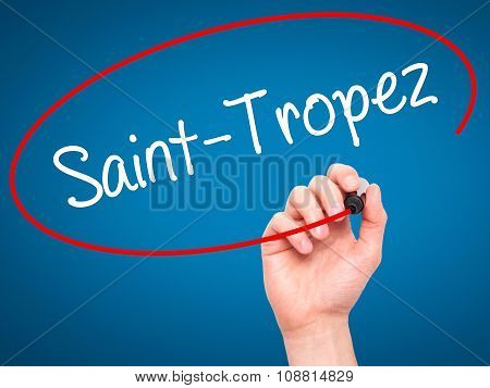 Man Hand writing Saint-Tropez with marker on visual screen