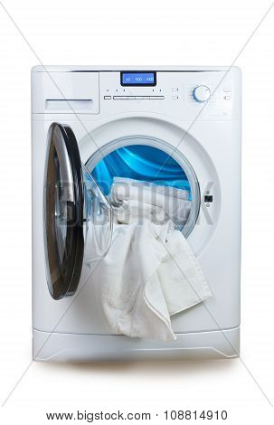 Washing machine and towels .close up on a white background