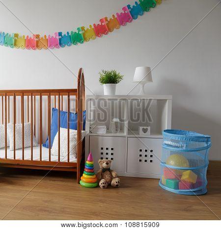 Wooden Cradle In Cosy Bedroom