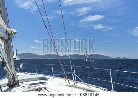 Sailing regatta. Sailing in the wind through the waves.