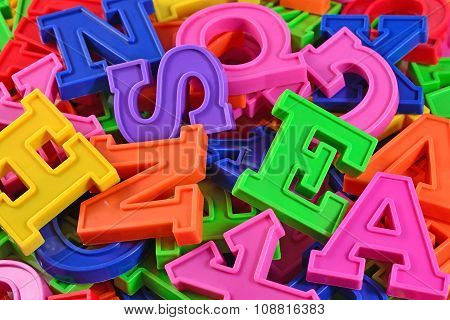 Heap Of Plastic Colored Alphabet Letters Close Up