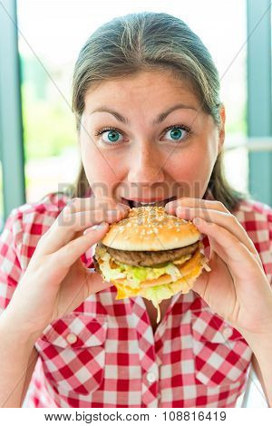 Hungry Girl Holding Hands A Hamburger