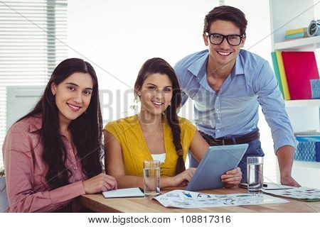 Young creative team having a meeting in casual office