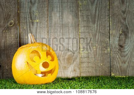 Halloween Pumpkin Near Wooden Boards.