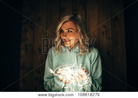 woman holding electric garland