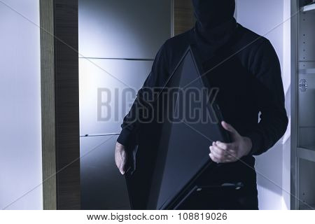 Thief Holding Modern Expensive Television